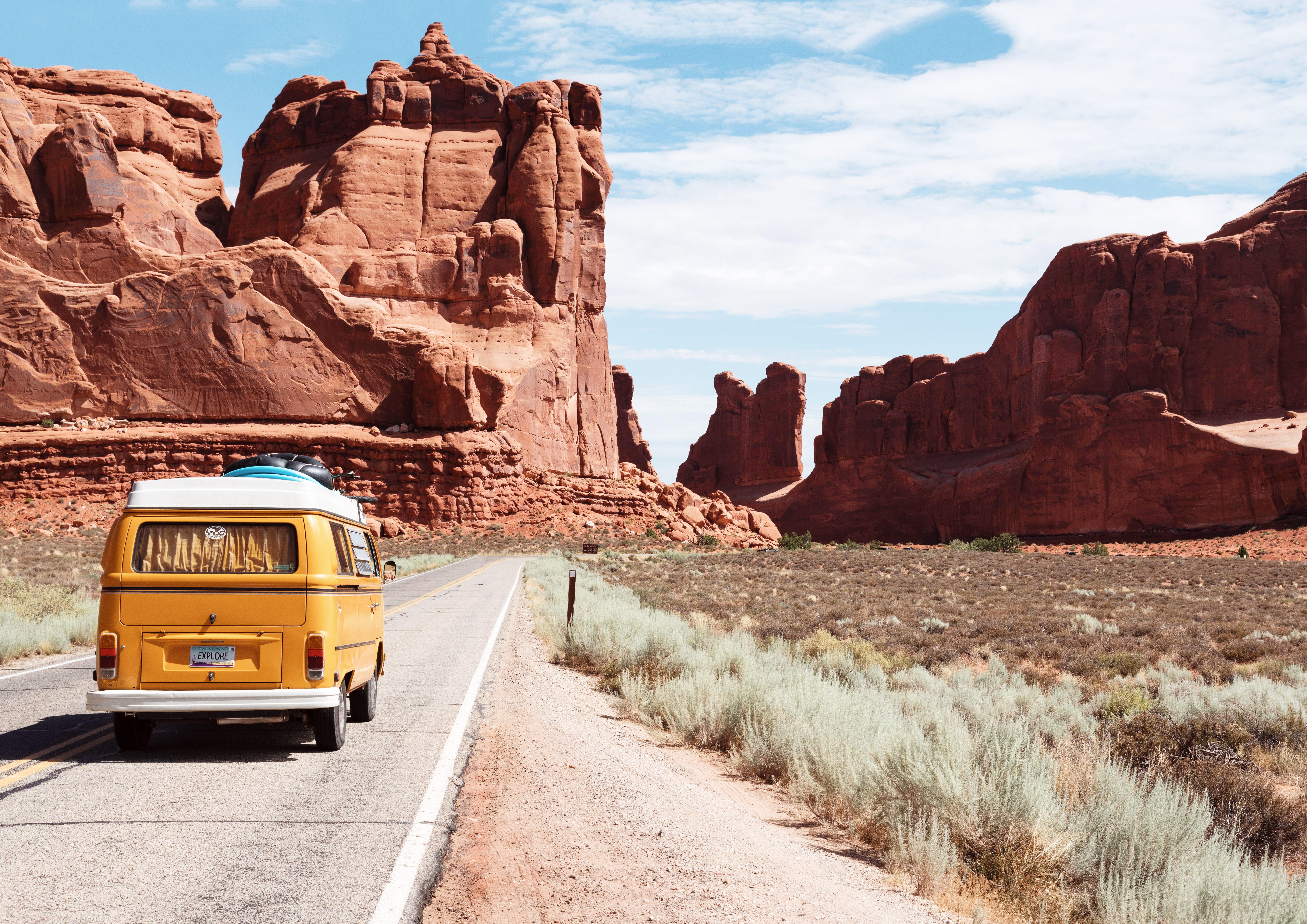 A volkswagen van driving into a desert